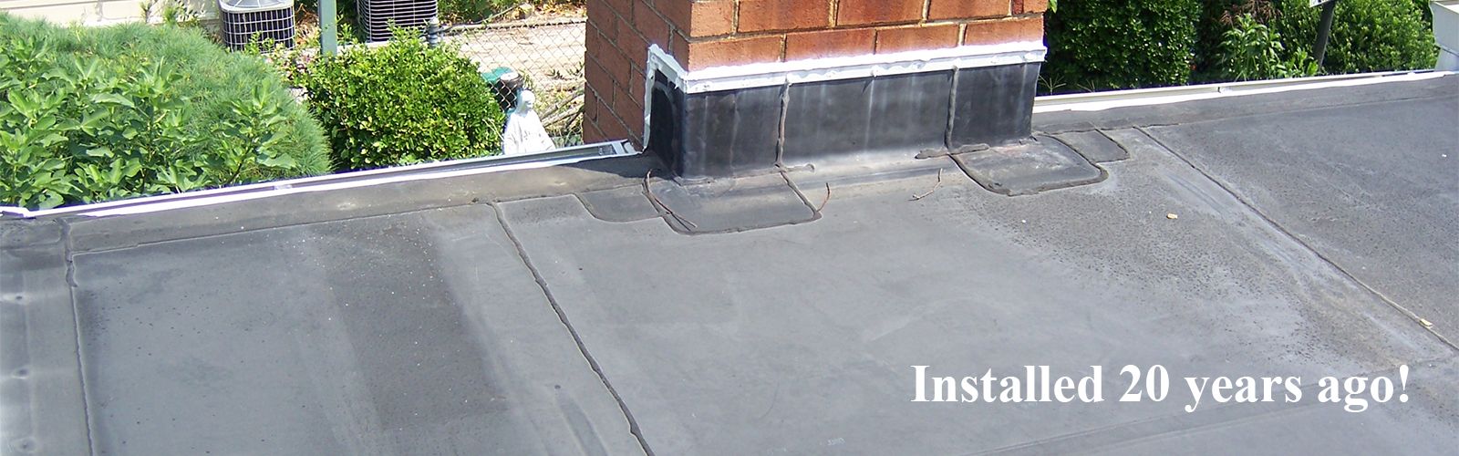 Residential EPDM Flat Roof Install over 20 years ago